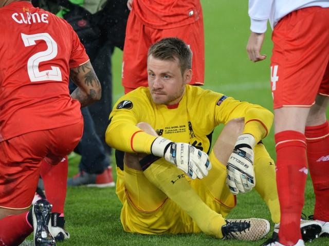 Simon Mignolet kon Sevilla in de tweede helft nog even afstoppen maar finaal was er geen stoppen aan voor de doelman van de Reds! Foto - David Catry